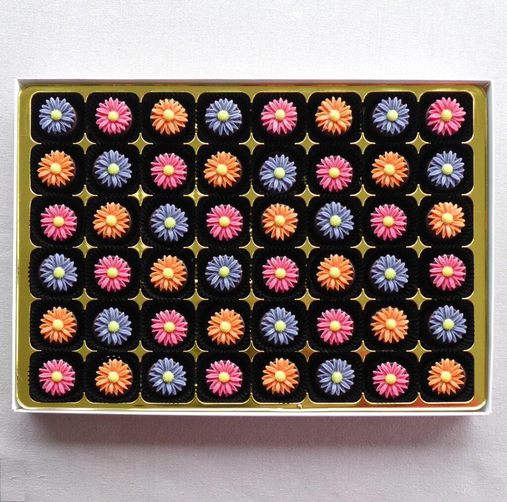 Marzipan daisies on chocolates